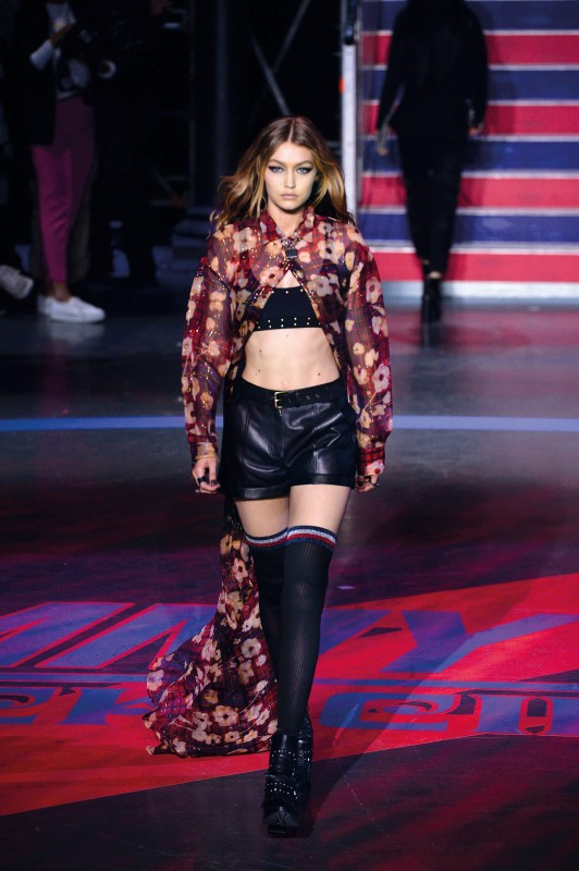 Model Gigi Hadid displays a creation from the Tommy Hilfiger Spring/Summer 2018 show in a presentation at London Fashion Week
